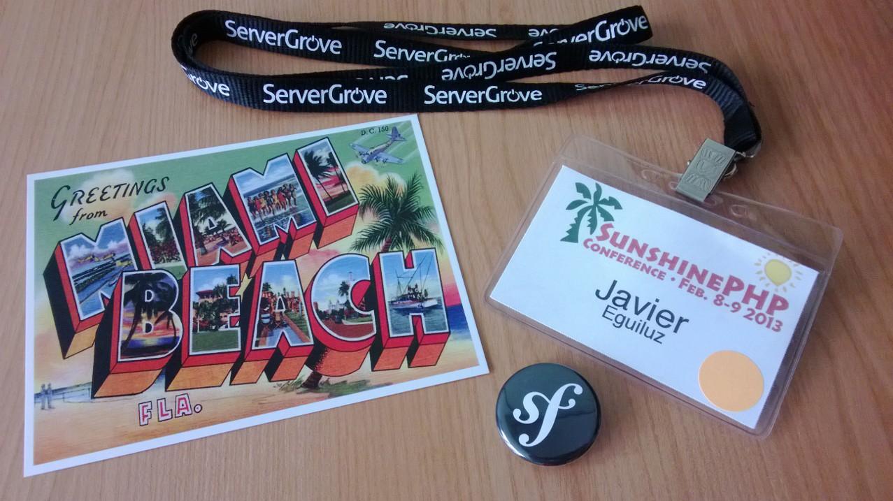 Badge de ponente y postal de recuerdo de Miami
